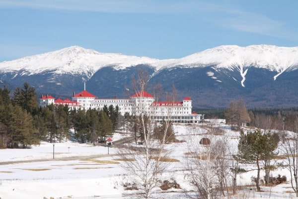 Snow-capped mountains behind the Omni Mount Washington Resort in Bretton Woods NH, about five hours from Ottawa. Photo by Laura Byrne Paquet.
