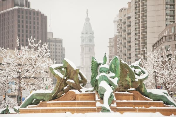 Snow on statues in Swann Memorial Fountain in Philadelphia.
