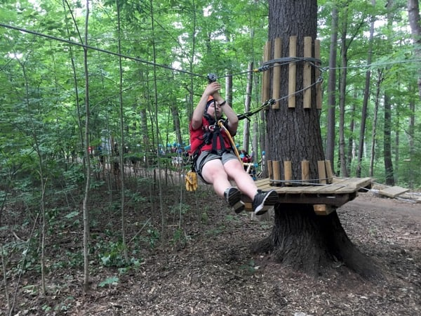 Guide Hannah Muysson demonstrates the basics of zip lining before we start. Photo by Laura Byrne Paquet.