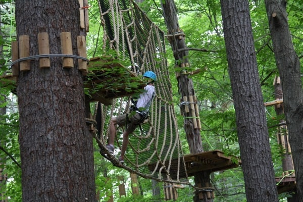 The adventure courses include all sorts of nets and other challenges, suspended high above the forest floor. Photo by Laura Byrne Paquet.