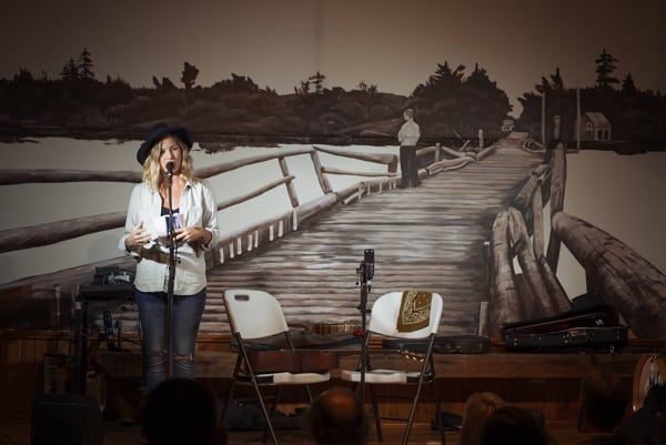 You can see a mural by local artist Laurel Cook of the now-gone Floating Bridge at the Union Hall in Clayton, which is one of the stops on the Crown and Pumpkin Studio Tour. Photo of Kelly Prescott in front of the mural courtesy of the Festival of Small Halls.