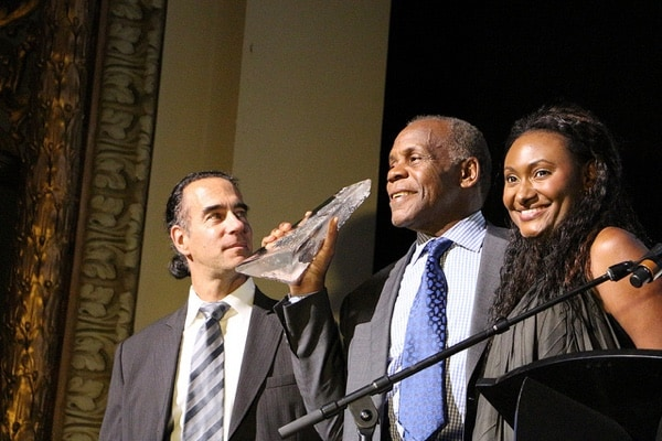 Danny Glover accepts an award at the Montreal International Black Film Festival in 2013. Flickr/Creative Commons photo by Christine Jackowski.