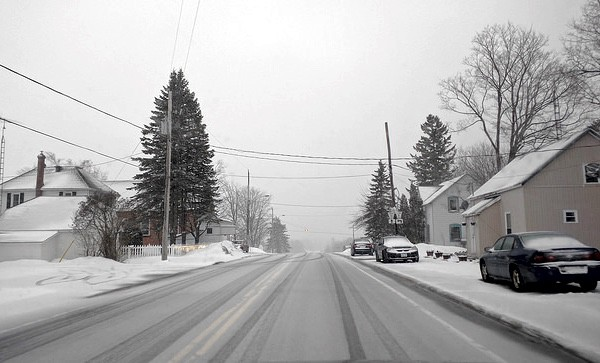 Icy and snowy road in Middleville, Ontario.