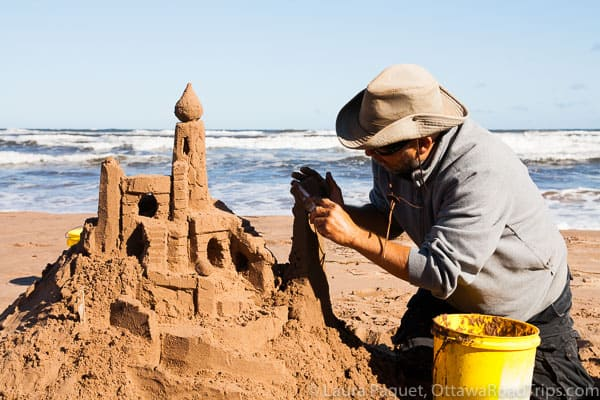 Master sandcastle builder Maurice Bernard demonstrates his skills on Brackley Beach in Prince Edward Island National Park.