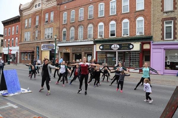 People dancing on a Brockville street.