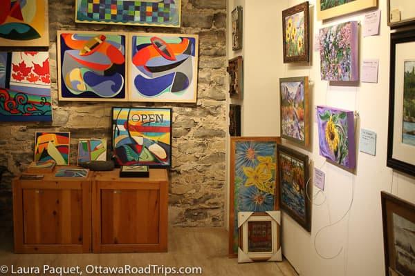 Art on walls of Martello Alley art gallery in Kingston.