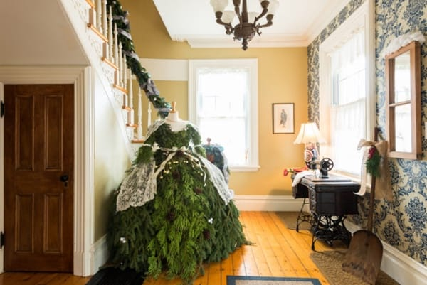 A mannequin dressed in Christmas boughs to resemble a Victorian lady in a foyer during the Vankleek Hill Christmas Home Tour 2016.