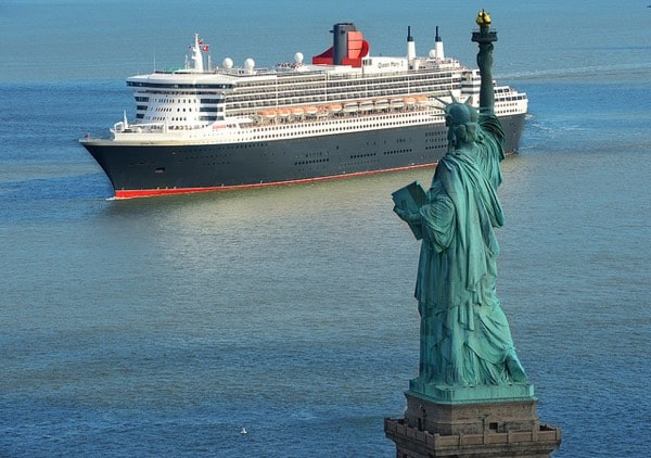 Cunard's Queen Mary 2 cruise ship and the Statue of Liberty in New York City.