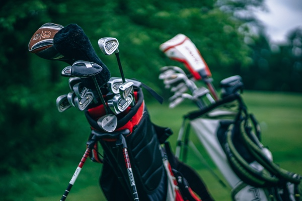Golf clubs in bags.