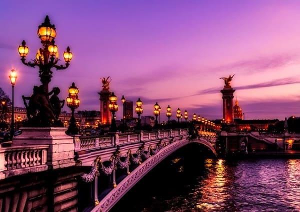 Paris bridge at night.