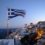 Greek coastline at twilight with Greek flag in foreground.