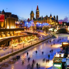 Rideau Canal at twilight with skaters and Christmas Lights Across Canada.