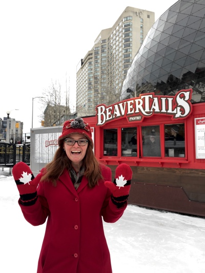 Skater in front of Beavertails stand on Rideau Canal in downtown Ottawa.